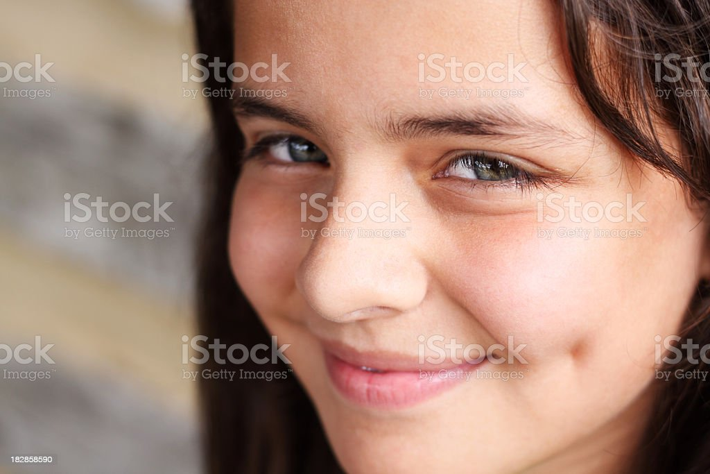 Pretty young girl with dimples smiling royalty-free stock photo