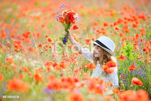 istock pretty young girl with flowers in hand and beautiful nature around 881864528