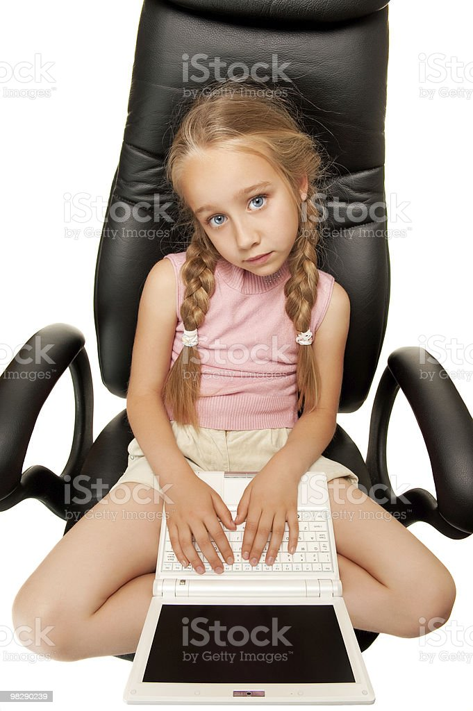Pretty young girl with laptop sitting on a chair royalty-free stock photo