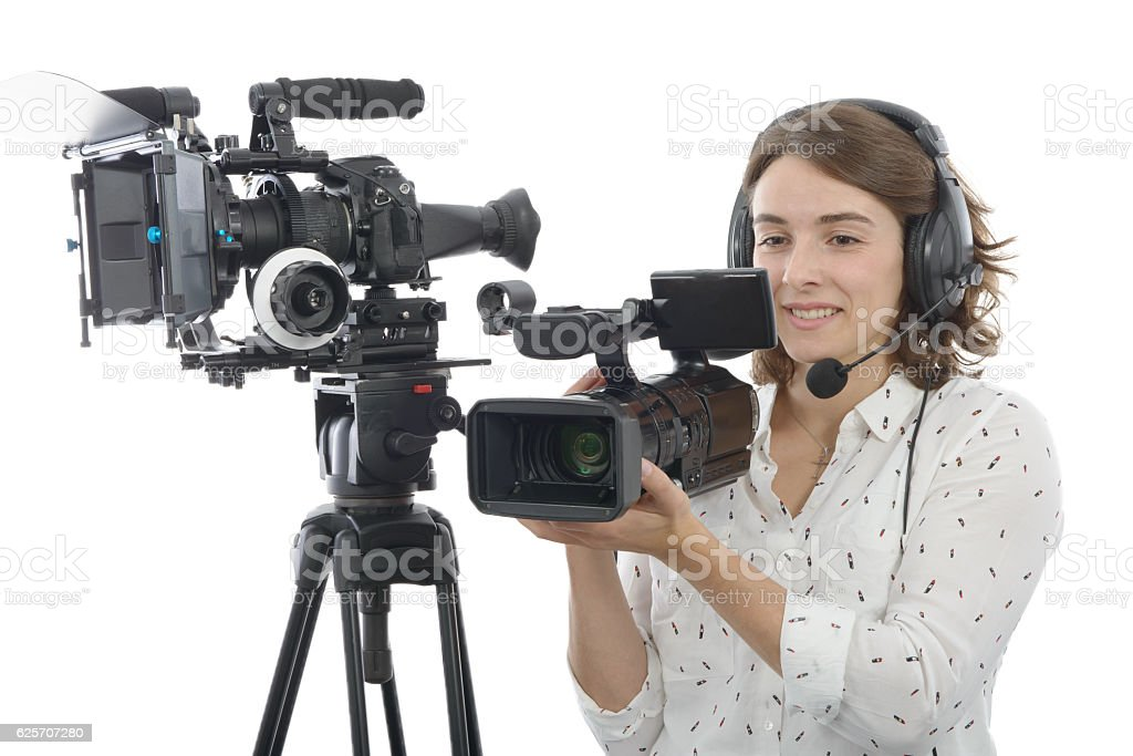 pretty young  girl with  professional camcorder, on white stock photo