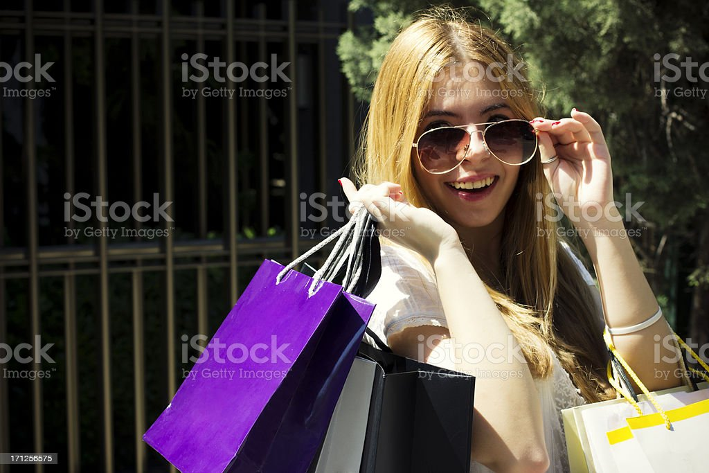 Pretty young girl with shopping bags royalty-free stock photo