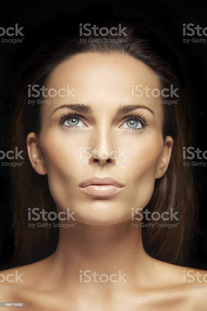 Pretty young lady looking up royalty-free stock photo