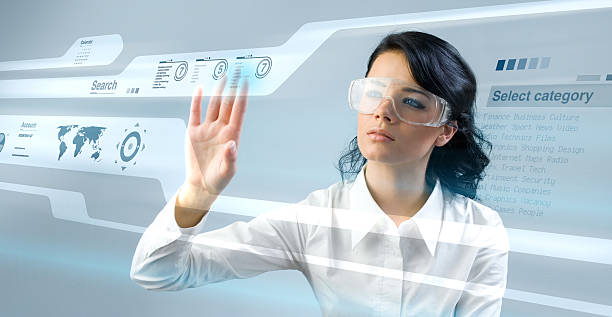 Pretty young lady using new technologies stock photo