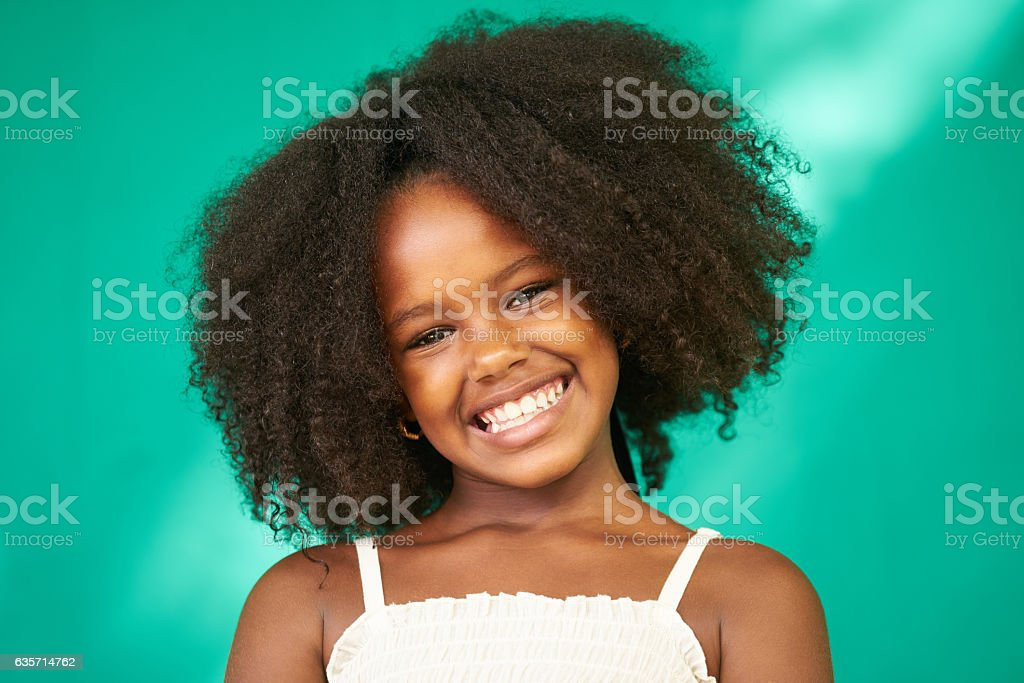 Pretty Young Latina Girl Cute Black Female Child Smiling royalty-free stock photo