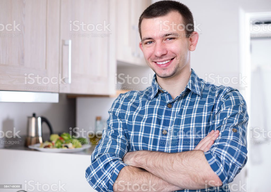 Pretty young man posing in the kitchen – Foto