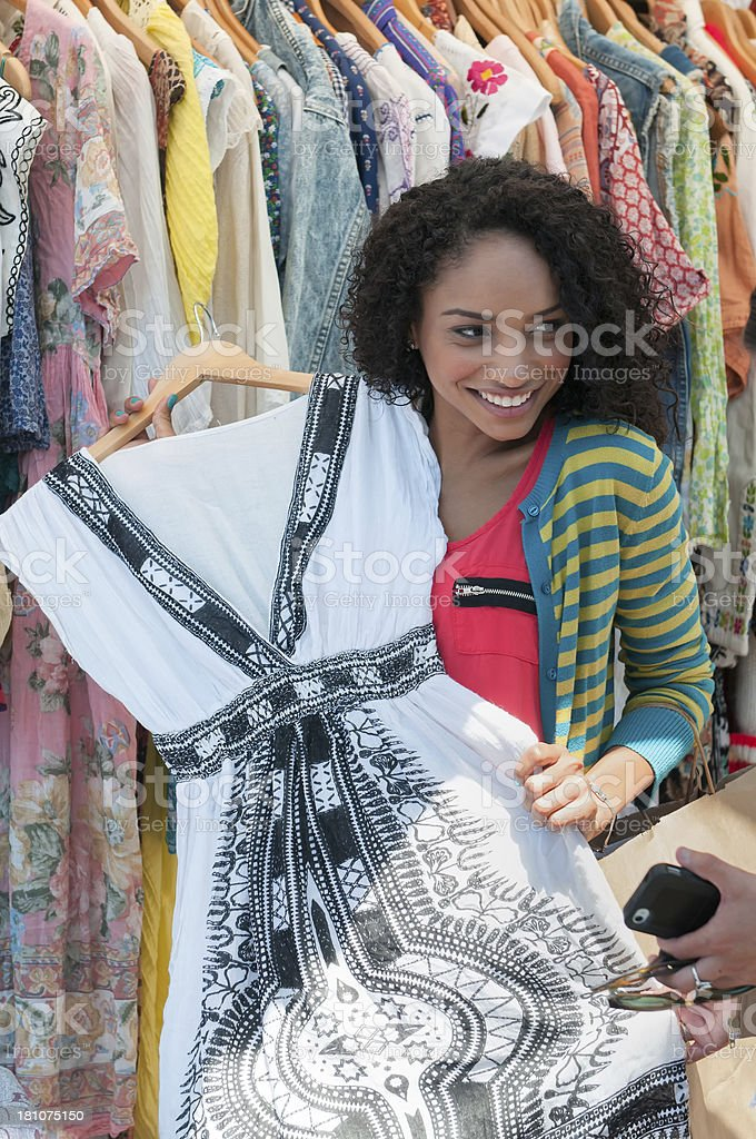 Pretty, Young Mixed-Ethnic Woman Shopping For Dress royalty-free stock photo