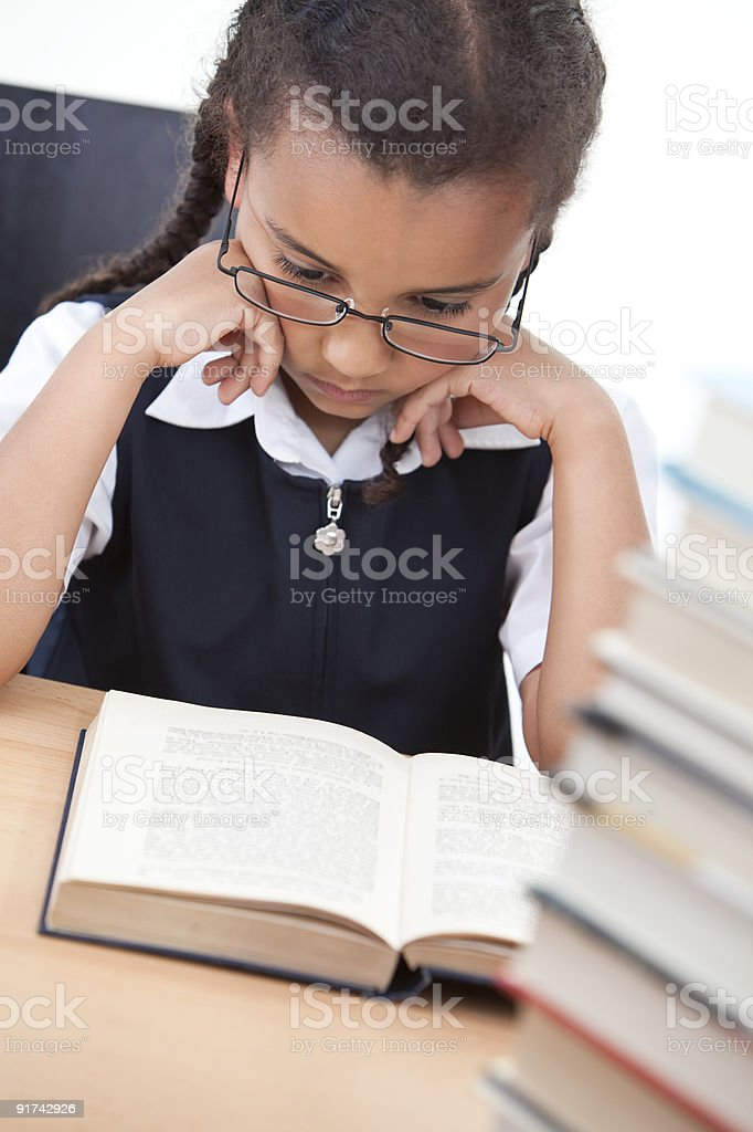 Pretty Young School Girl Reading A Book royalty-free stock photo