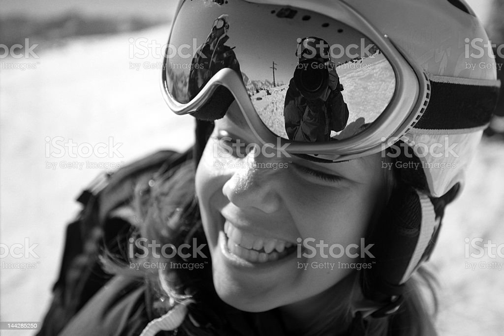 Pretty young smiling girl with snowboard goggles royalty-free stock photo