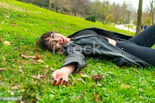 521982322 istock photo Pretty young teenage girl relaxing on a grass 1200930614