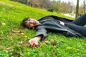 istock Pretty young teenage girl relaxing on a grass 1200930614