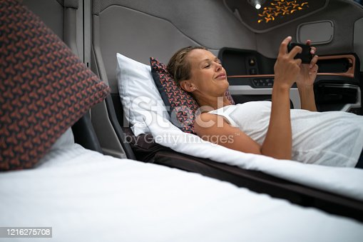 istock Pretty, young woman abord a first class commercial flight 1216275708