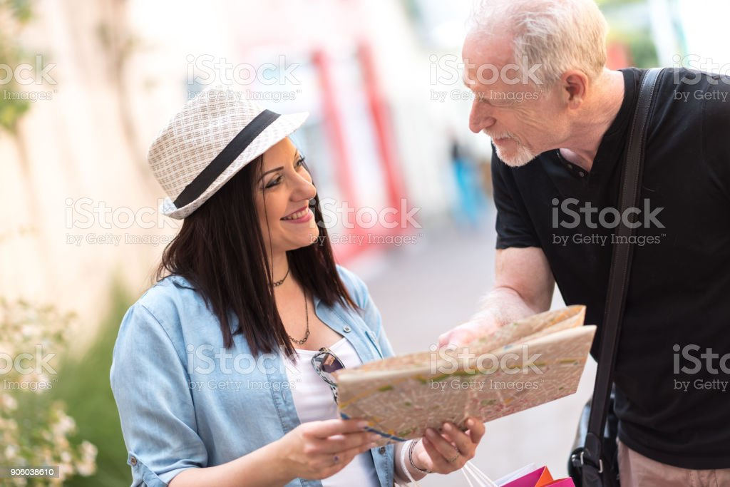 Pretty young woman asking for direction stock photo