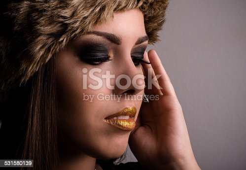 istock Pretty young woman displaying her eye makeup 531580139