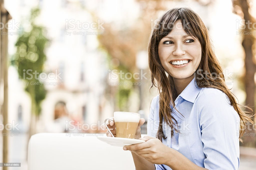 Pretty young woman drinking a cup of coffee royalty-free stock photo