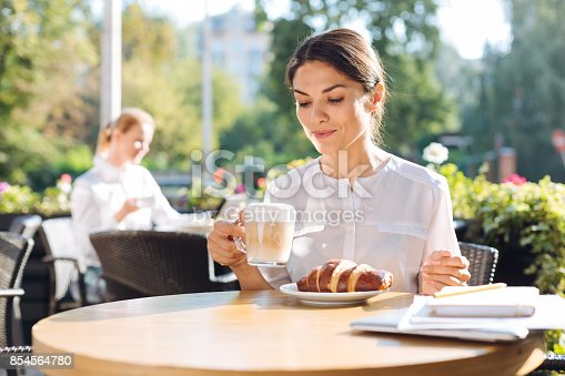 istock Pretty young woman drinking latte in cafe 854564780