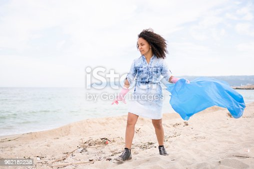 962184460 istock photo Pretty young woman during local clean up 962182238