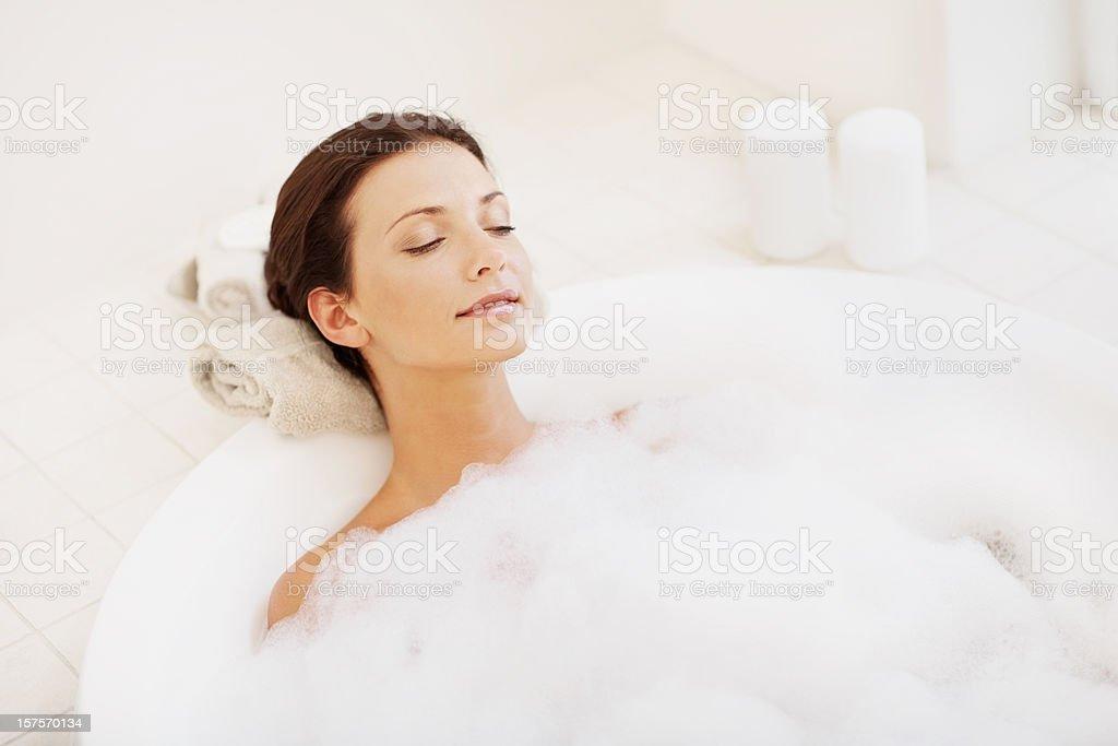 Pretty young woman enjoying bubble bath royalty-free stock photo