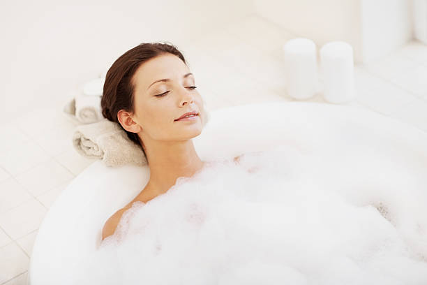 Pretty young woman enjoying bubble bath  bubble bath stock pictures, royalty-free photos & images