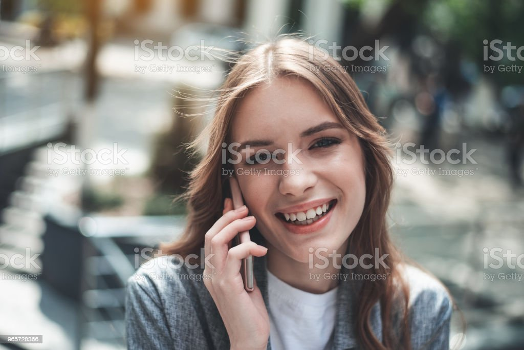 Pretty young woman enjoying communication on the phone - Royalty-free Adult Stock Photo