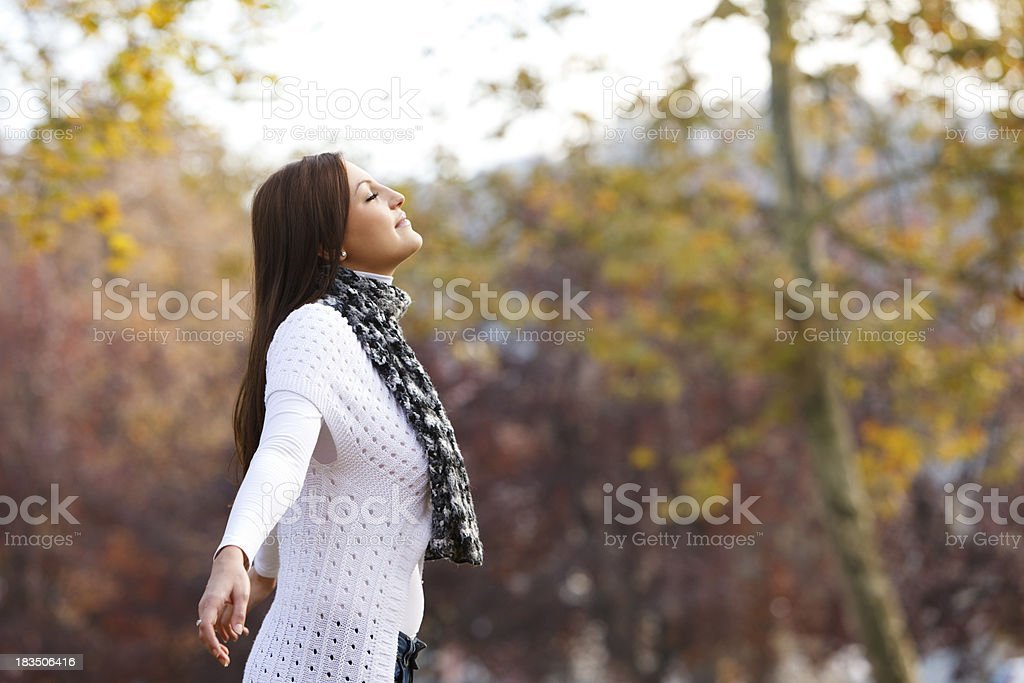 Pretty young woman enjoying the nature royalty-free stock photo