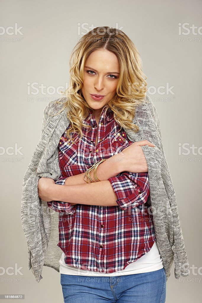 Pretty young woman freezing with cold royalty-free stock photo
