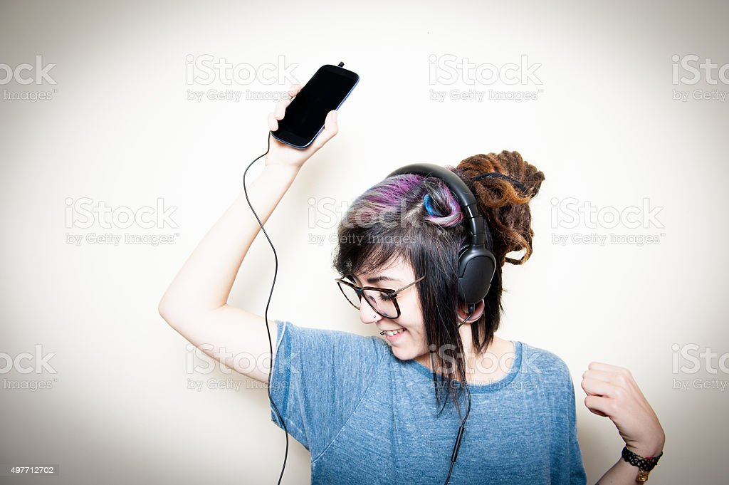 Pretty young woman happy while listening music stock photo