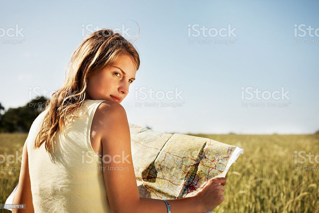 Pretty young woman holding a map royalty-free stock photo