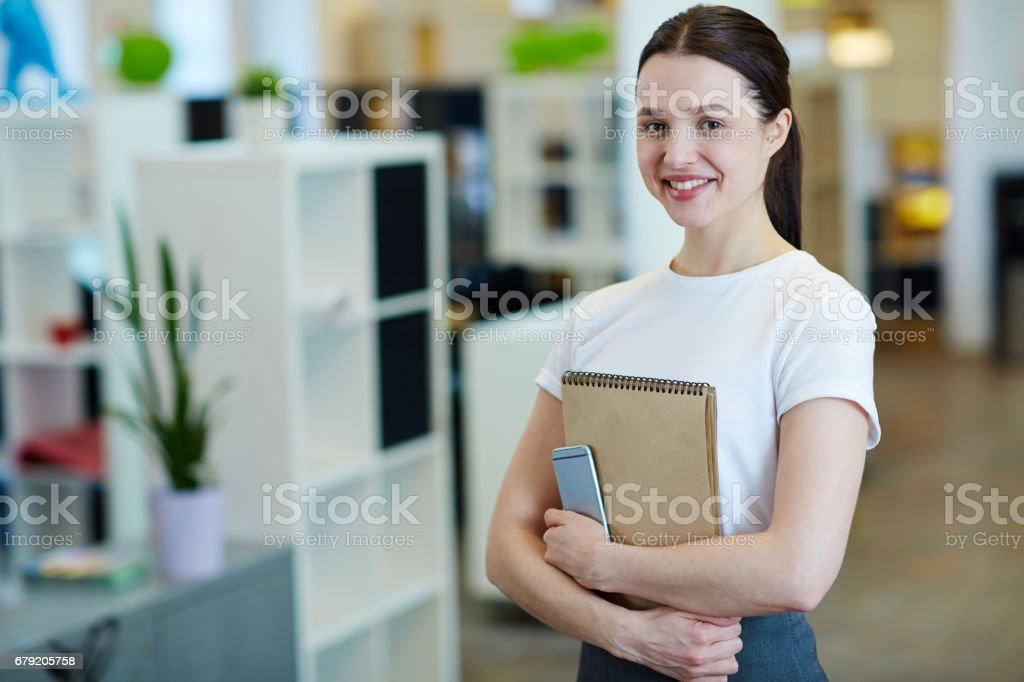 Pretty Young Woman in Office – Foto
