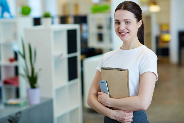 Pretty Young Woman in Office stock photo