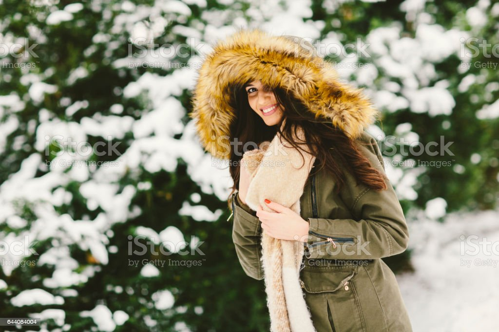 Pretty young woman in the winter park stock photo