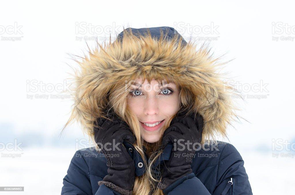 Pretty young woman in trendy winter fashion stock photo