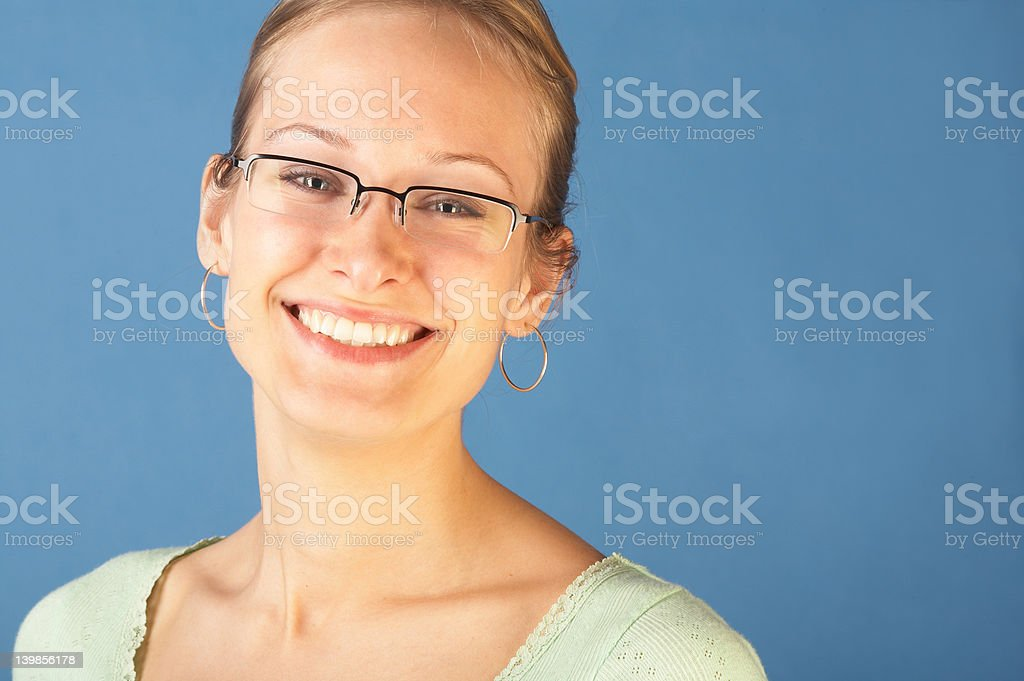 Pretty young woman looking happy royalty-free stock photo