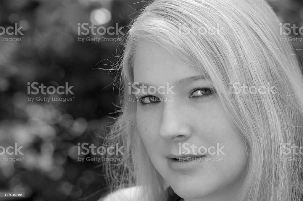 Pretty young woman looking seriously stock photo