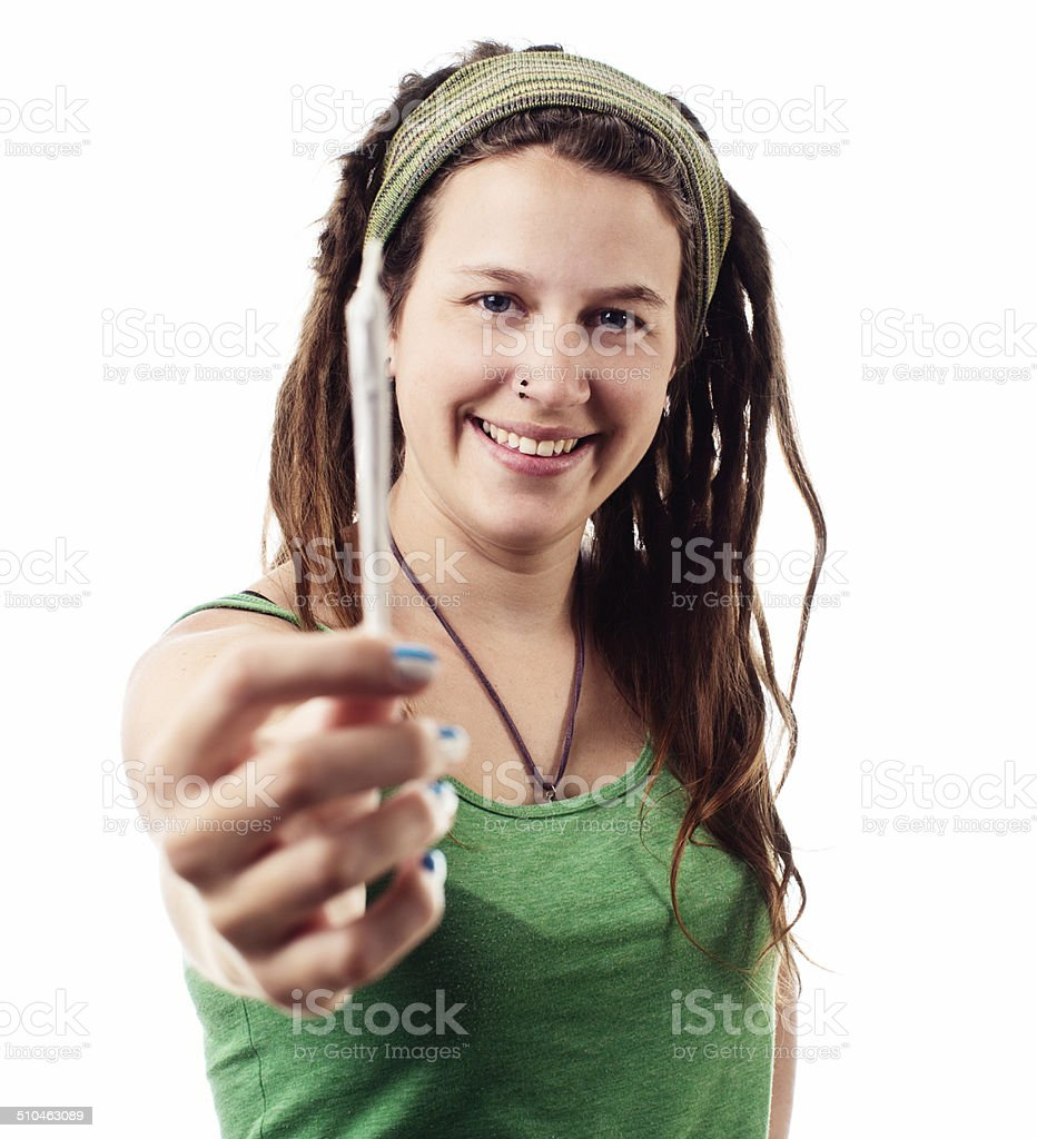Pretty young woman offers a marijuana joint, smiling stock photo