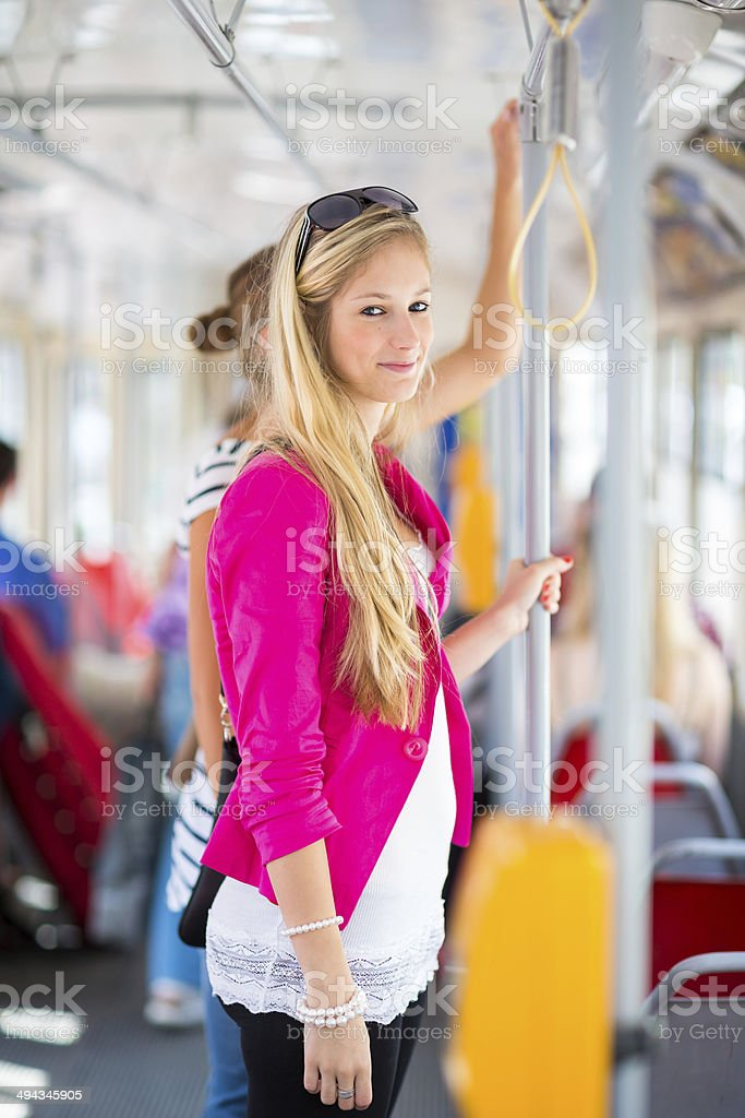 Pretty, young woman on a streetcar/tramway stock photo