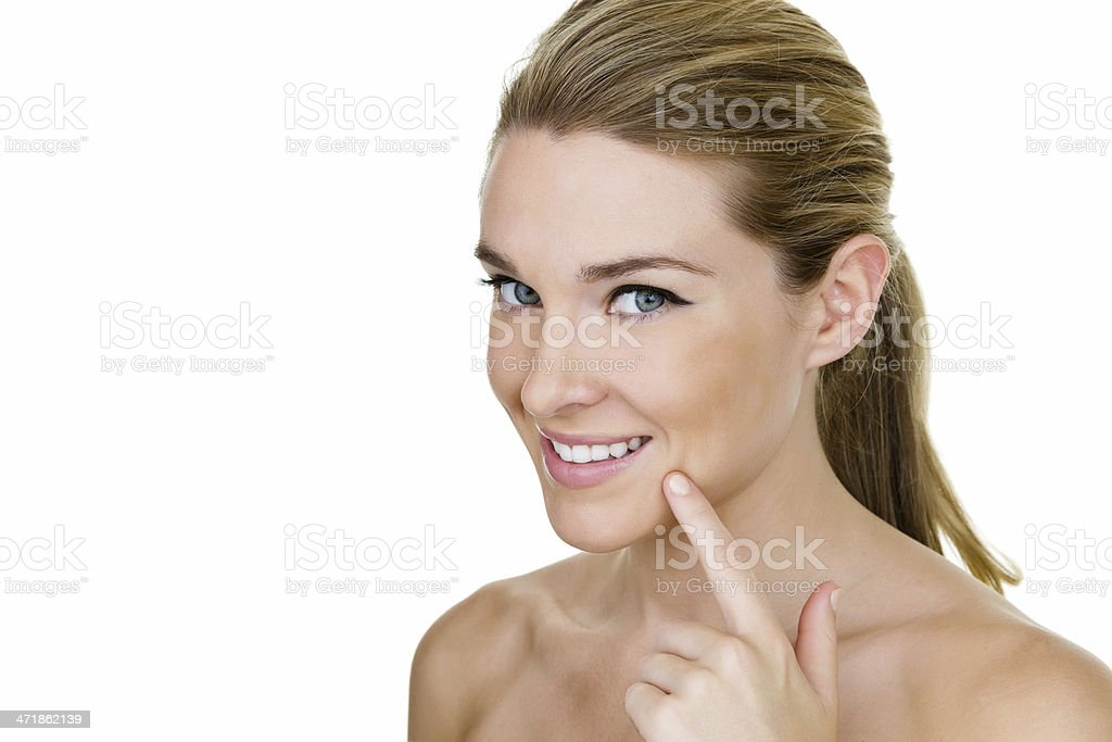 Pretty young woman pointing to her beautiful smile stock photo