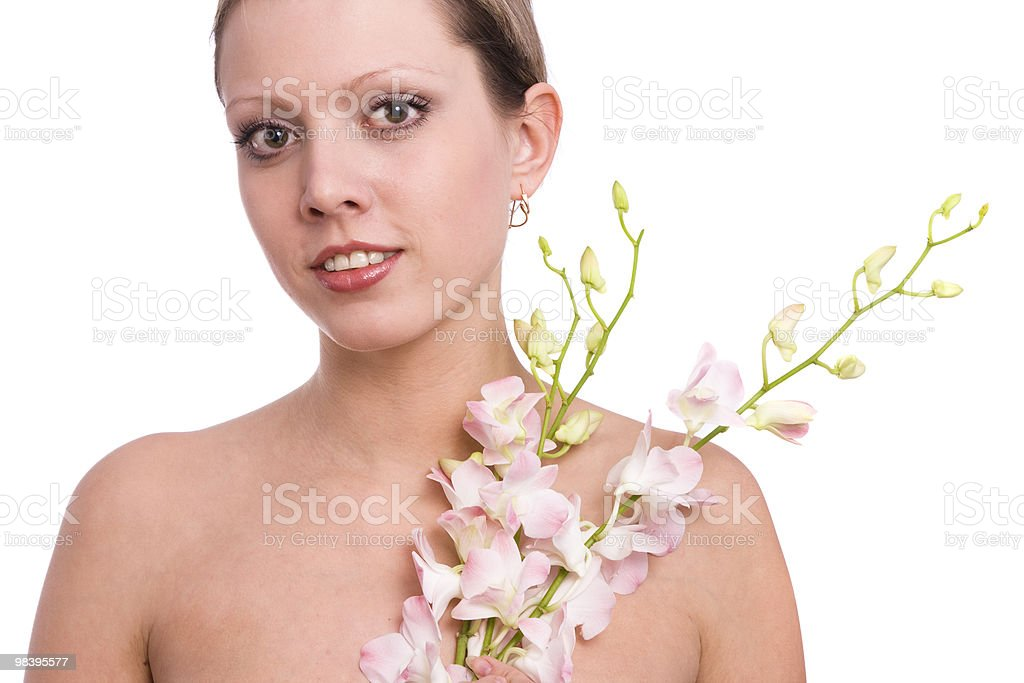 Pretty young woman portrait with orchid royalty-free stock photo