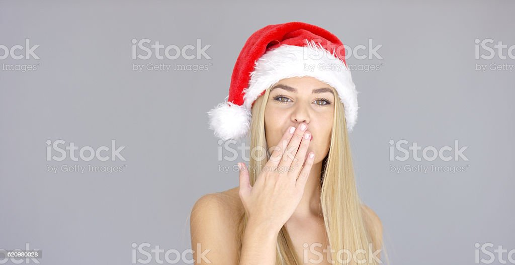 Pretty young woman posing in Santa Claus Hat foto royalty-free