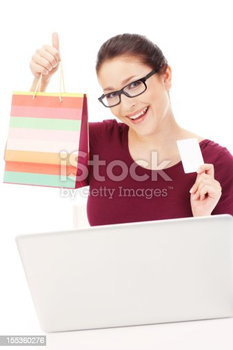 Pretty Young Woman Shopping Online with Laptop