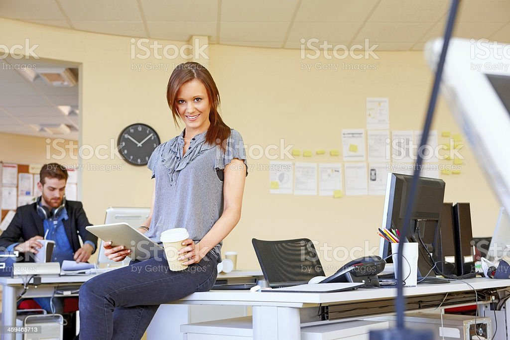 Pretty young woman sitting at her desk royalty-free stock photo