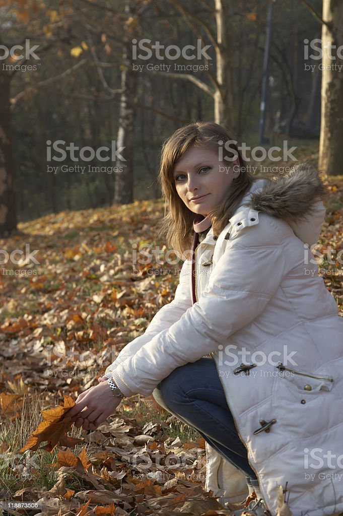 Pretty young woman sitting in the park royalty-free stock photo