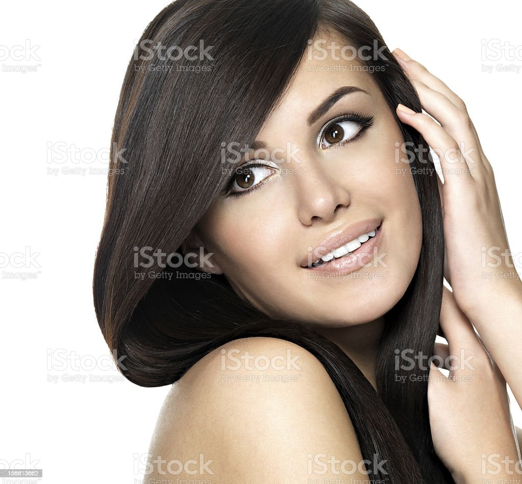 Pretty young woman smiling with long hair stock photo