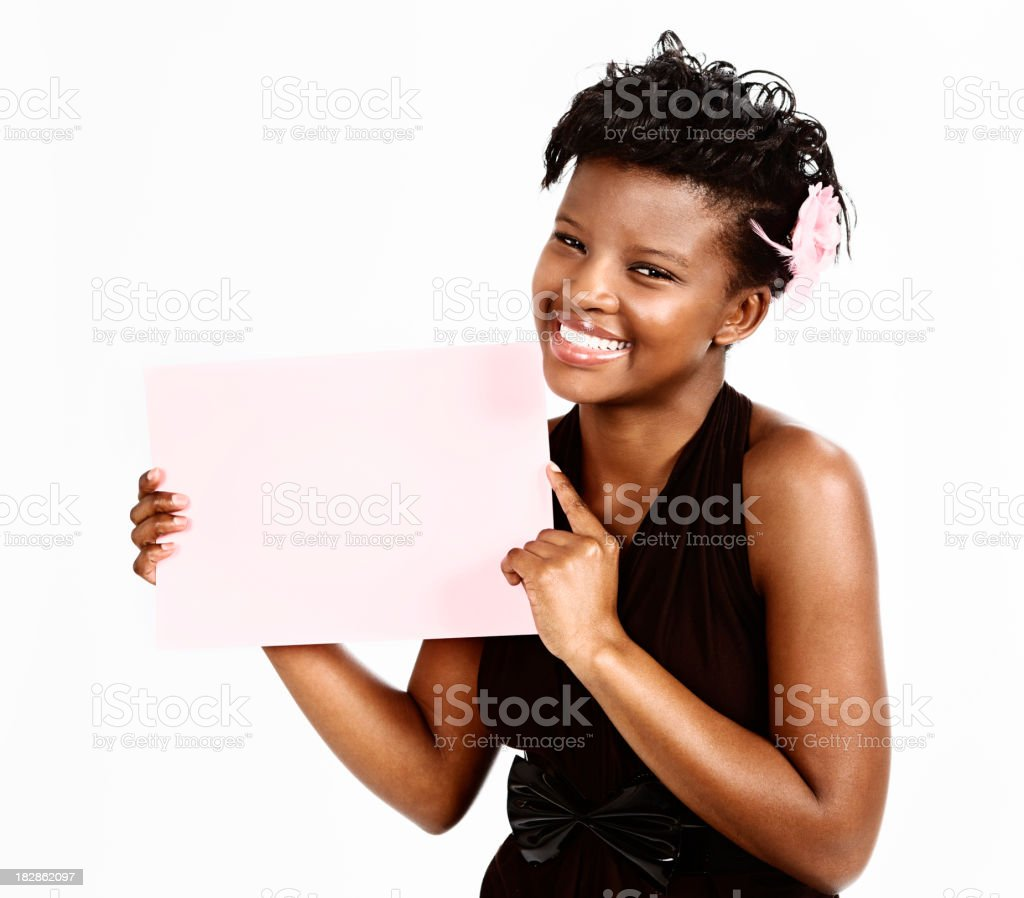 Pretty young woman smilingly displays blank sign stock photo