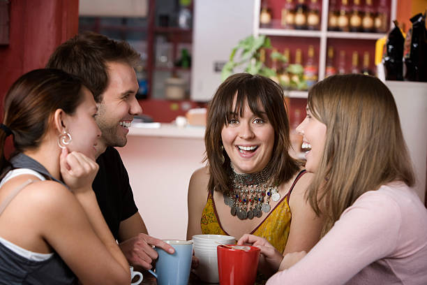 Pretty Young Woman Surrounded by Friends stock photo