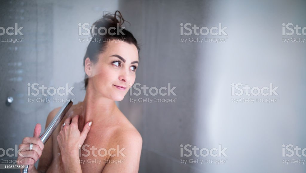 Woman Washing Hair In Outdoor Shower On Summer Day Stock