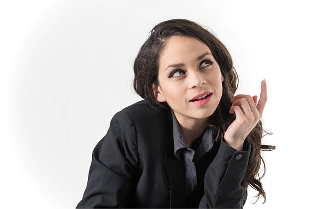 Pretty young woman thinking stock photo
