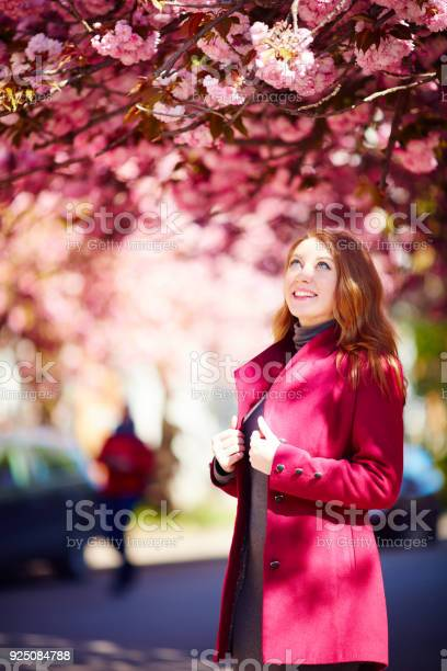 Pretty young woman under blooming cherry blossom tree sakura picture id925084788?b=1&k=6&m=925084788&s=612x612&h=8bmmyotybnovvmzve25gw7koiwderjk5y5gybs7t8ig=