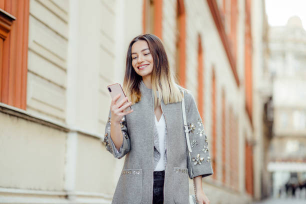 Pretty young woman using a phone stock photo