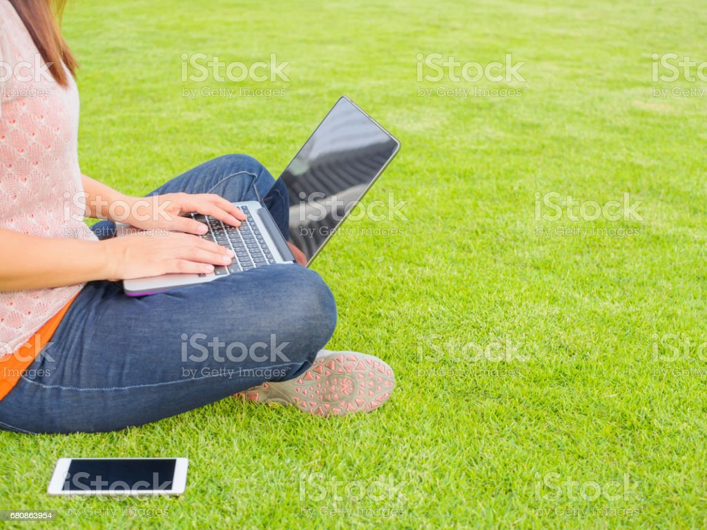 Pretty Young woman using laptop computer. royalty-free stock photo