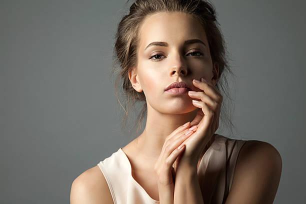 Pretty young woman watching at camera stock photo